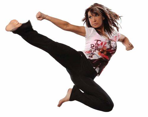 Cynthia Rothrock executing a flying kick