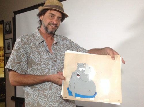 Bill Kopp, animator, writer and voice actor, displays an animation cell