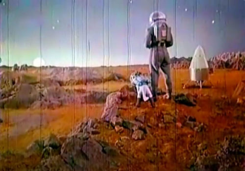 Dog and hooman on the Martian surface, from Pavel Klushantsev's Mars (1968)
